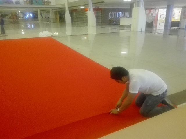 Red carpet installation in malls